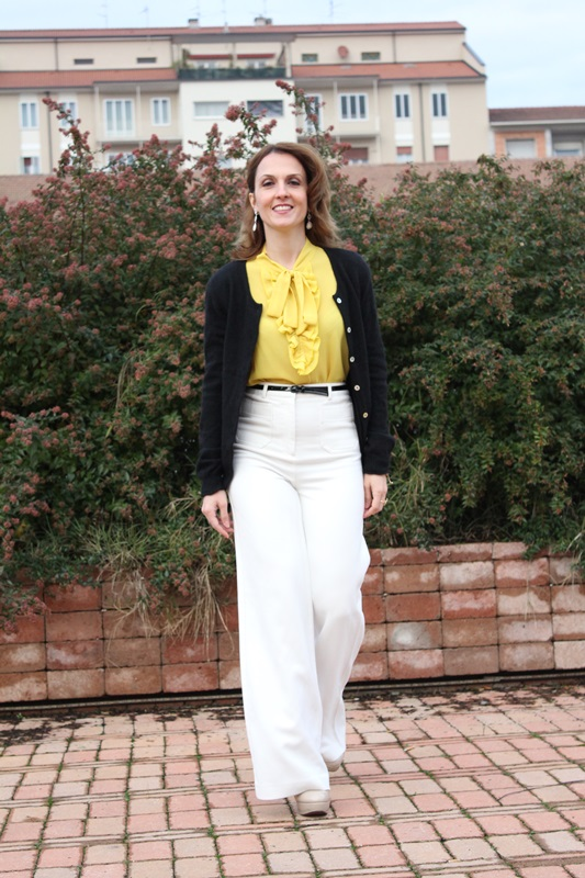 IndianSavage Margaret Dallospedale The Indian Savage diary yellow shirt, white pants and black cardigan 0