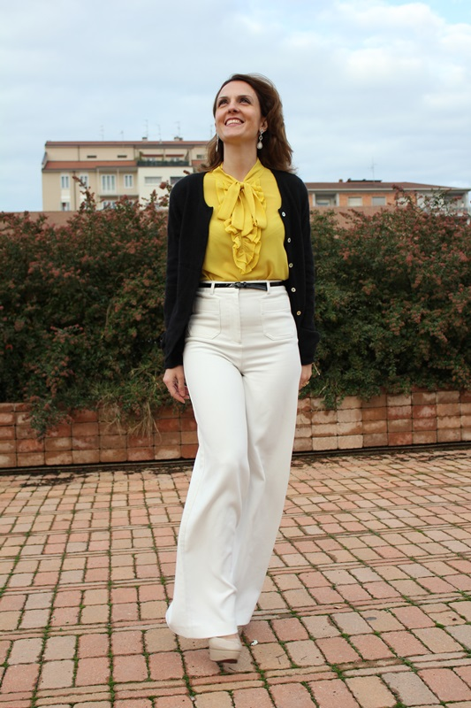 IndianSavage Margaret Dallospedale The Indian Savage diary yellow shirt, white pants and black cardigan 2